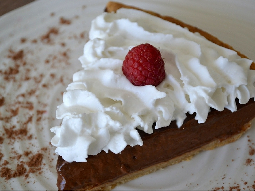 This delicious chocolate banana pie uses a secret ingredient, making it extra healthy. Topped with coconut whipped cream, it's a huge dessert hit.